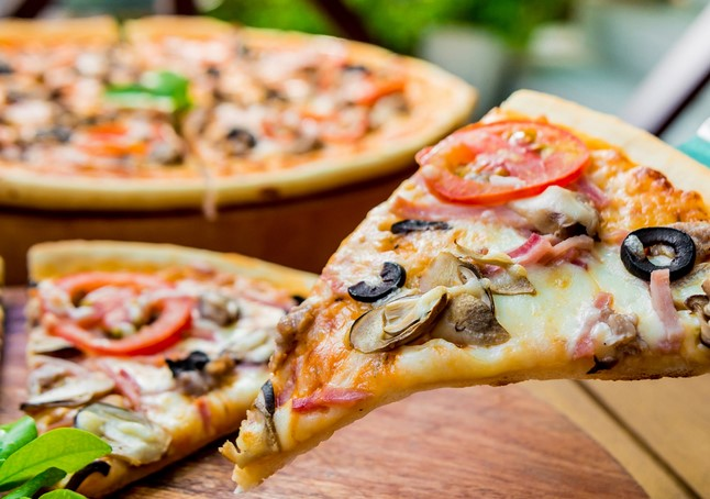 Пицца — вкусное блюдо со многими начинками